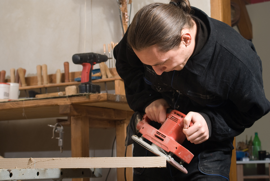 Carpenter building a workbench out of wood
