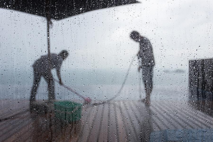 Pressure washing in the rain